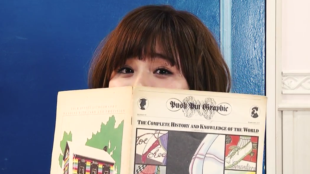 "Monari Wakita pretends to read and cook in ""Boy Friend"" MV"